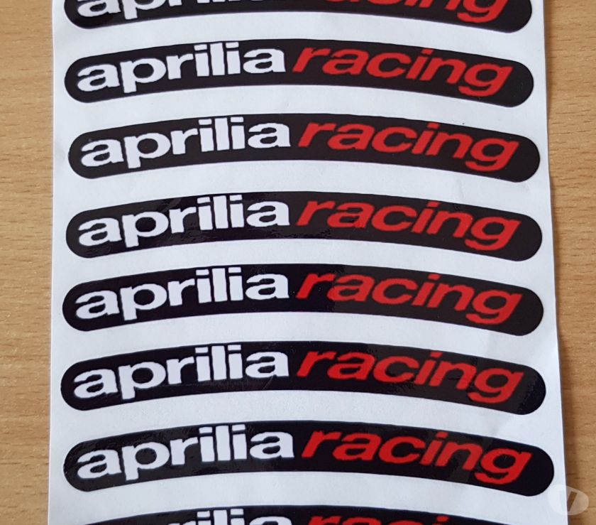 Photos Vivastreet Autocollant sticker de jante x8 Aprilia racing fond noir