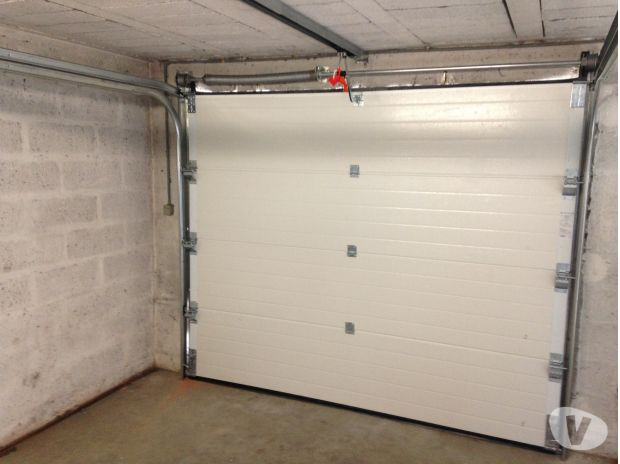 Porte de garage sectionnelle issou 78440 mat riel for Porte de garage sectionnelle 3 5 m