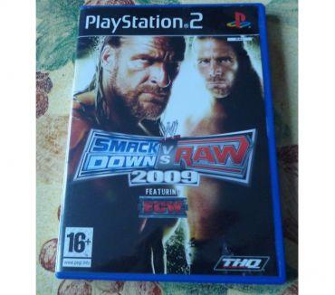 Photos Vivastreet Jeux PS 2 smack downs 2009 avec boite et notice
