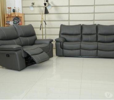 Photos for Recliner sofas 3 seater and 2 seater in leather colour grey