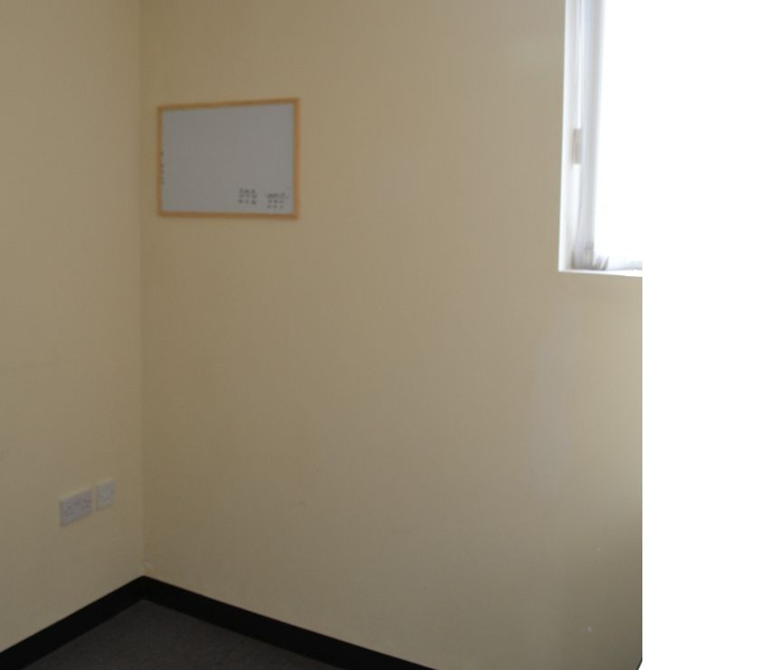 Photos for Corner office suite available for rent.